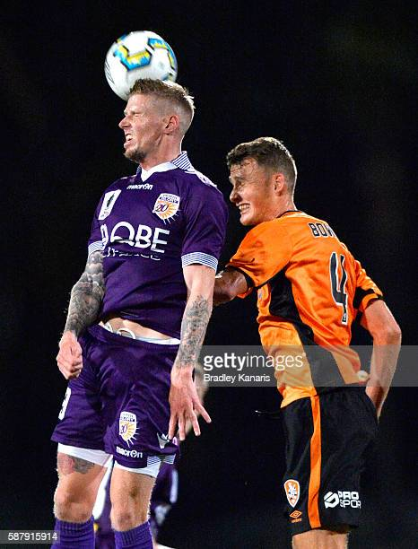 Andrew Keogh of the Glory and Daniel Bowles of the Roar challenge for the ball during the FFA Cup round of 32 match between the Brisbane Roar and...