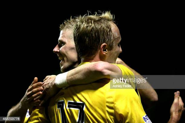 Andrew Keogh of the Glory celebrates a goal with teammate Mitch Nichols during the FFA Cup match between the Newcastle Jets and the Perth Glory at...