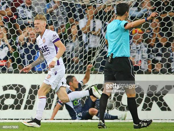 Andrew Keogh of the Glory celebrates after scoring the first goal as Mark Milligan of the Victory looks dejected in the goal during the round 20...
