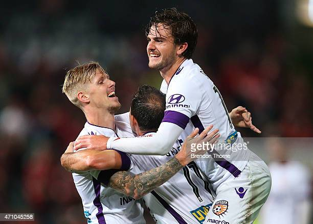 Andrew Keogh of the Glory celebrates with team mates Joshua Risdon and Richard Garcia after scoring a goal during the round 27 ALeague match between...