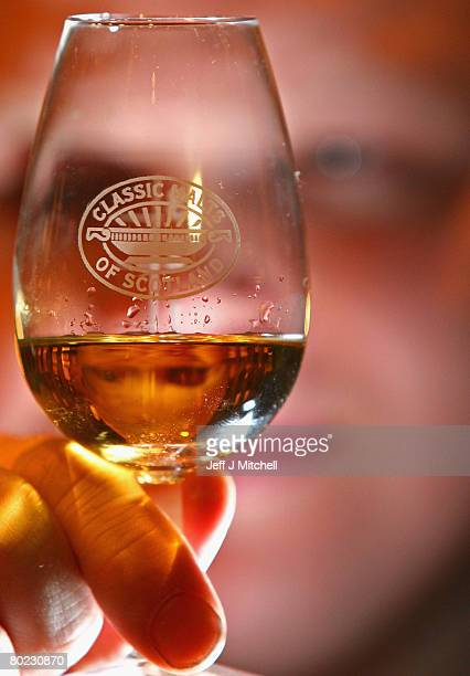 Andrew Kirk a malt advocate holds a glass of whisky at Glenkinchie distillery March 13 2008 in Edinburgh Scotland Chancellor Alistair Darling has...