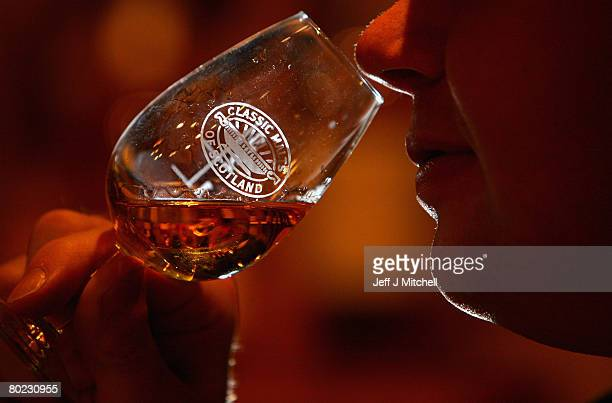Andrew Kirk a malt advocate noses a glass of whisky at Glenkinchie distillery March 13 2008 in Edinburgh Scotland Chancellor Alistair Darling has...