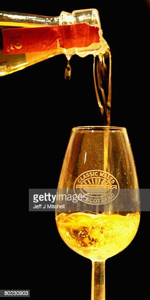 Andrew Kirk a malt advocate pours a glass of whisky at Glenkinchie distillery March 13 2008 in Edinburgh Scotland Chancellor Alistair Darling has...