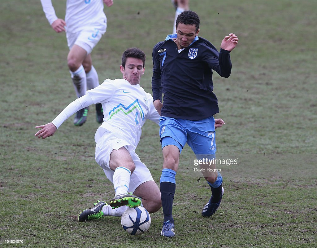 Andrew Kiwomya of England is tackled by Matic Zupanc during the UEFA European Under 17 Championship match between England and Slovenia at Pirelli Stadium on March 28, 2013 in Burton-upon-Trent, England.
