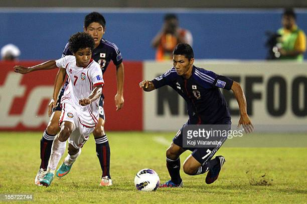 Andrew Kumagaii of Japan and W Ambar of UAE compete for the ball during the AFC U19 Championship Group A match between the United Arab Emirates and...