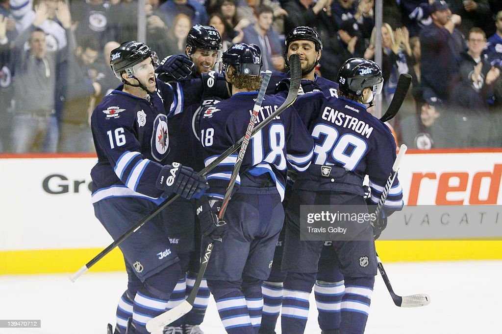 Andrew Ladd #16, Blake Wheeler #26, Bryan Little #18, Dustin Byfuglien #33 and Tobias Enstrom #39 of the Winnipeg Jets celebrate a second period goal against the Philadelphia Flyers at the MTS Centre on February 21, 2012 in Winnipeg, Manitoba, Canada.