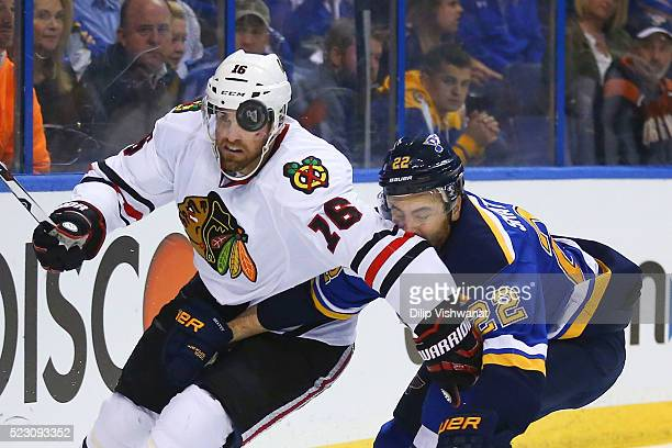 Andrew Ladd of the Chicago Blackhawks and Kevin Shattenkirk of the St Louis Blues fight for control of the puck in Game Five of the Western...