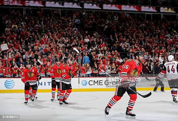 Andrew Ladd of the Chicago Blackhawks skates ahead of teammates Patrick Kane Trevor van Riemsdyk and Jonathan Toews after scoring against the Arizona...