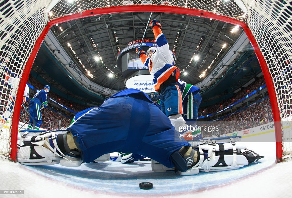 Andrew Ladd #16 of the New York Islanders celebrates his overtime winning goal on Ryan Miller #30 of the Vancouver Canucks during their NHL game at Rogers Arena March 9, 2017 in Vancouver, British Columbia, Canada. New York won 4-3 in overtime.