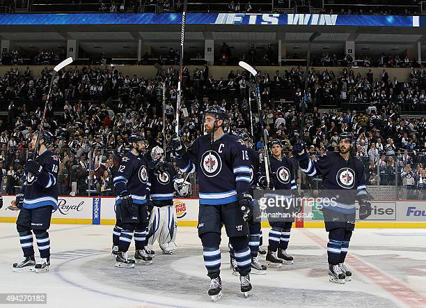 Andrew Ladd of the Winnipeg Jets and teammates salute the fans as they celebrate a 54 victory over the Minnesota Wild at the MTS Centre on October 25...