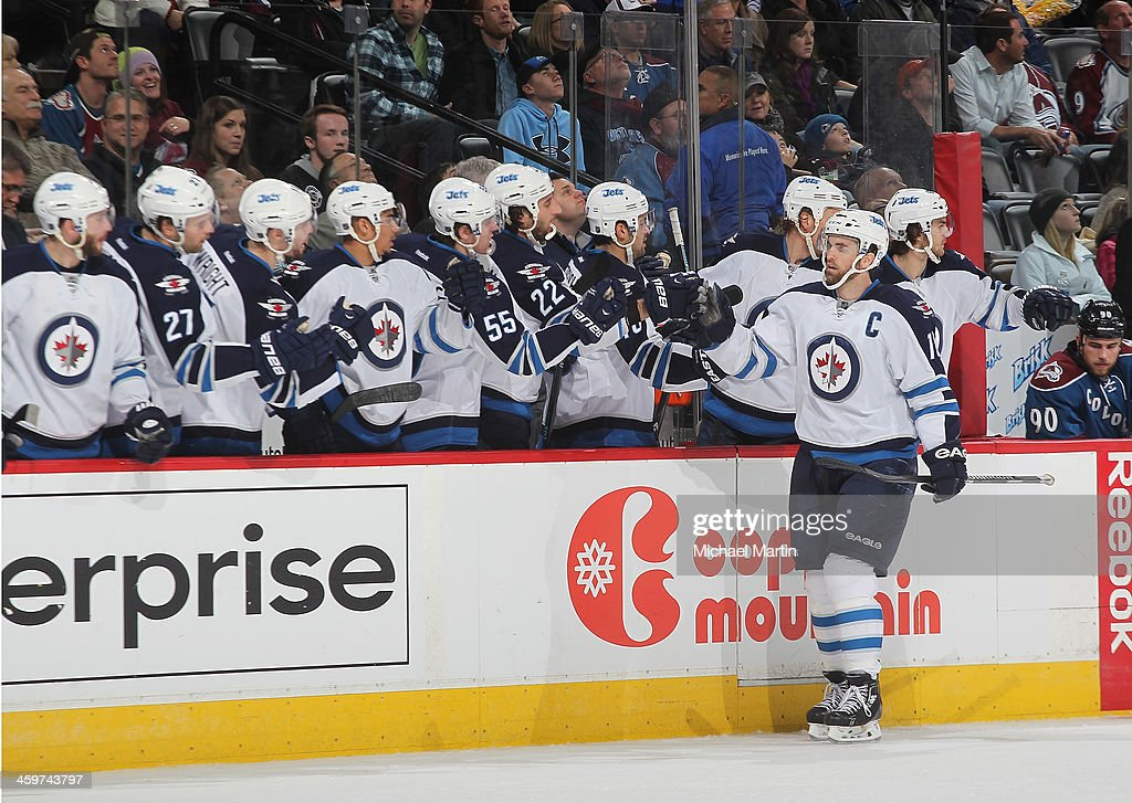 <a gi-track='captionPersonalityLinkClicked' href=/galleries/search?phrase=Andrew+Ladd&family=editorial&specificpeople=228452 ng-click='$event.stopPropagation()'>Andrew Ladd</a> #16 of the Winnipeg Jets celebrates a goal with teammates against the Colorado Avalanche at the Pepsi Center on December 29, 2013 in Denver, Colorado.ÊThe Jets defeated the avalanche 2-1 in overtime.