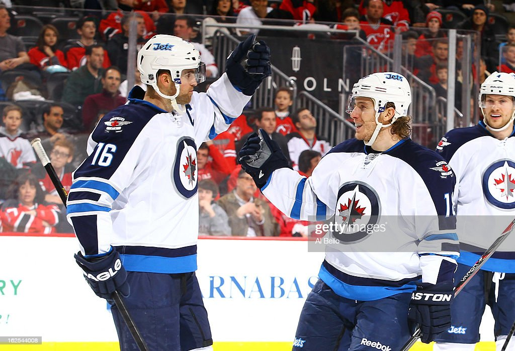 <a gi-track='captionPersonalityLinkClicked' href=/galleries/search?phrase=Andrew+Ladd&family=editorial&specificpeople=228452 ng-click='$event.stopPropagation()'>Andrew Ladd</a> #16 of the Winnipeg Jets celebrates his goal with <a gi-track='captionPersonalityLinkClicked' href=/galleries/search?phrase=Bryan+Little&family=editorial&specificpeople=540533 ng-click='$event.stopPropagation()'>Bryan Little</a> #18 of the Winnipeg Jets during their game against the New Jersey Devils at the Prudential Center on February 24, 2013 in Newark, New Jersey.