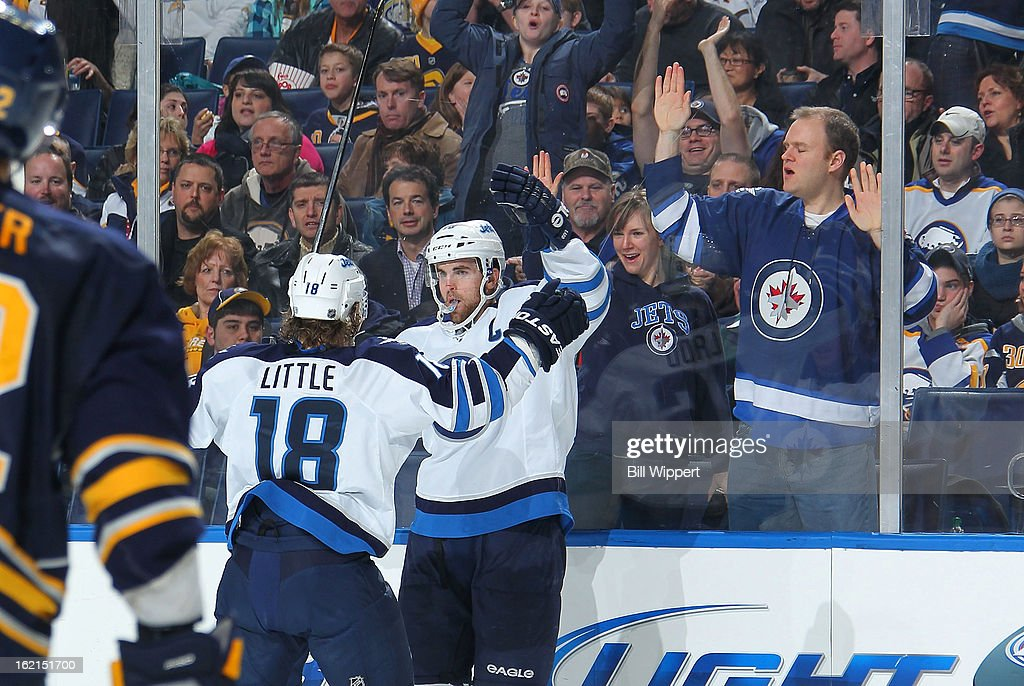 <a gi-track='captionPersonalityLinkClicked' href=/galleries/search?phrase=Andrew+Ladd&family=editorial&specificpeople=228452 ng-click='$event.stopPropagation()'>Andrew Ladd</a> #16 of the Winnipeg Jets celebrates his second period goal with teammate <a gi-track='captionPersonalityLinkClicked' href=/galleries/search?phrase=Bryan+Little&family=editorial&specificpeople=540533 ng-click='$event.stopPropagation()'>Bryan Little</a> #18 in their game against the Buffalo Sabres on February 19, 2013 at the First Niagara Center in Buffalo, New York.