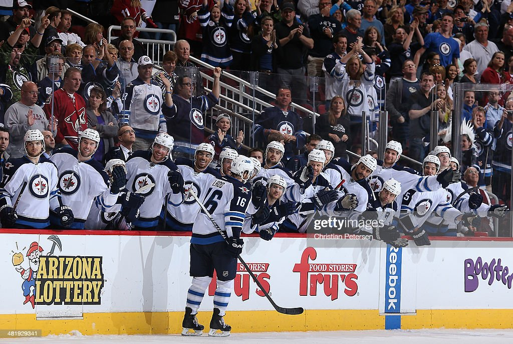 Andrew Ladd #16 of the Winnipeg Jets celebrates with teammates on the bench after scoring a shootout goal against the Phoenix Coyotes in the NHL game at Jobing.com Arena on April 1, 2014 in Glendale, Arizona. The Jets defeated the Coyotes 2-1 in an overtime shootout.