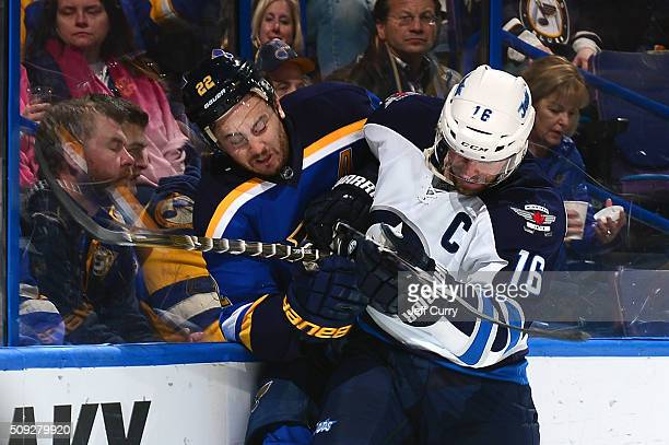 Andrew Ladd of the Winnipeg Jets checks Kevin Shattenkirk of the St Louis Blues at the Scottrade Center on February 9 2016 in St Louis Missouri