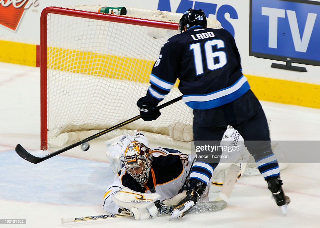 <a gi-track='captionPersonalityLinkClicked' href=/galleries/search?phrase=Andrew+Ladd&family=editorial&specificpeople=228452 ng-click='$event.stopPropagation()'>Andrew Ladd</a> #16 of the Winnipeg Jets dekes out goaltender Ryan Miller #30 of the Buffalo Sabres for a second period goal at the MTS Centre on April 9, 2013 in Winnipeg, Manitoba, Canada.