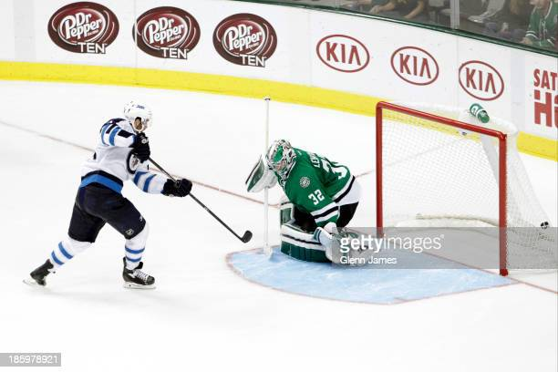 Andrew Ladd of the Winnipeg Jets gets a shootout winning goal against Kari Lehtonen of the Dallas Stars at the American Airlines Center on October 26...