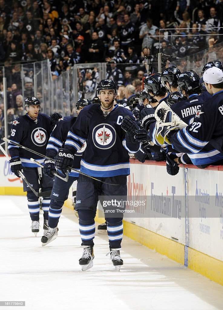 Andrew Ladd #16 of the Winnipeg Jets gets congratulated by teammates at the bench following a late third period goal against the Pittsburgh Penguins at the MTS Centre on February 15, 2013 in Winnipeg, Manitoba, Canada.