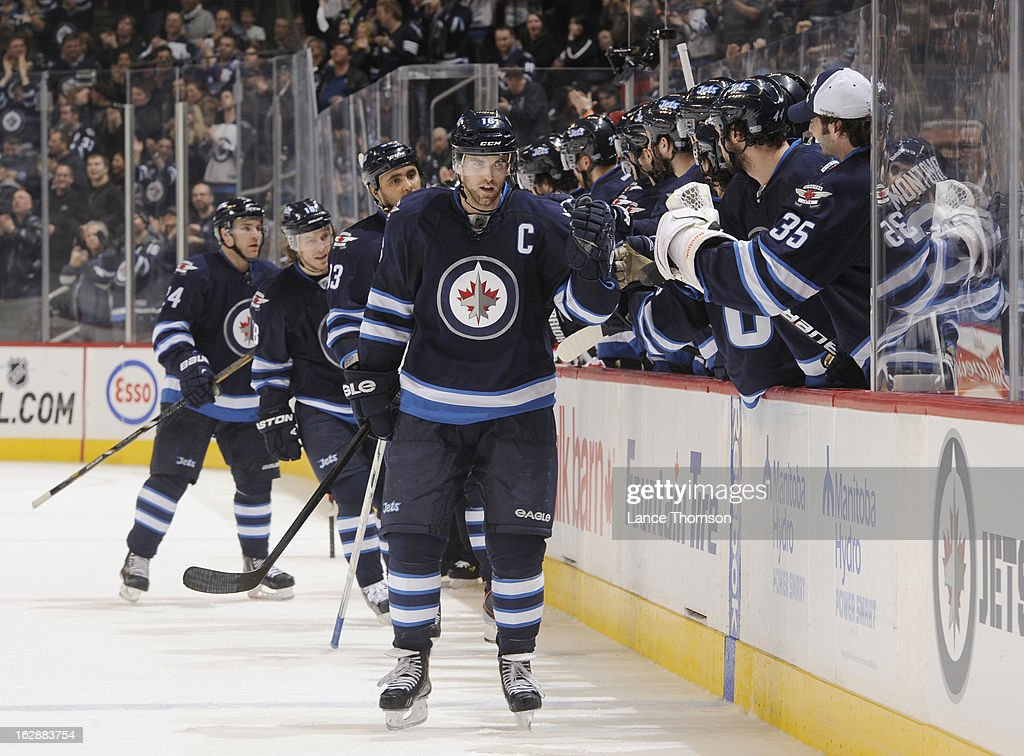 Andrew Ladd #16 of the Winnipeg Jets gets congratulated by teammates at the bench after scoring the go-ahead goal in the third period against the New Jersey Devils at the MTS Centre on February 28, 2013 in Winnipeg, Manitoba, Canada.