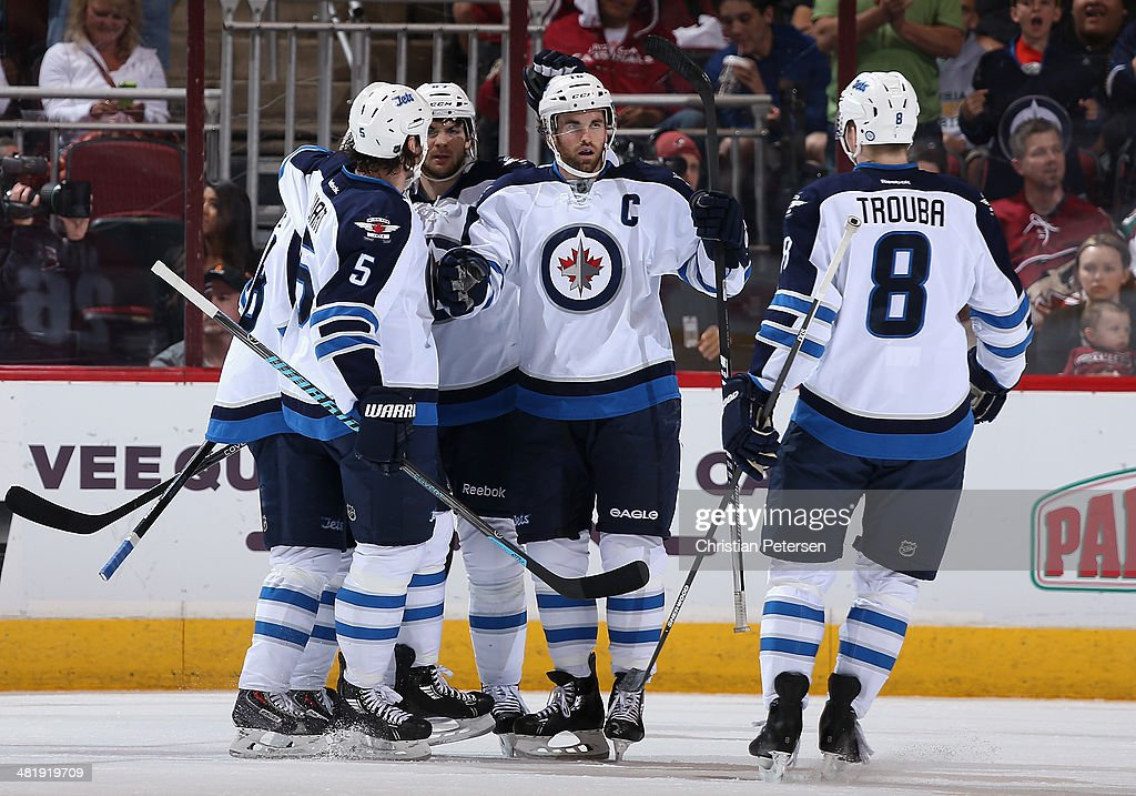 Andrew Ladd #16 of the Winnipeg Jets is congratulated by Mark Stuart #5, Bryan Little #18, Michael Frolik #67 and Jacob Trouba #8 after Ladd scored a first period goal against the Phoenix Coyotes during the NHL game at Jobing.com Arena on April 1, 2014 in Glendale, Arizona.