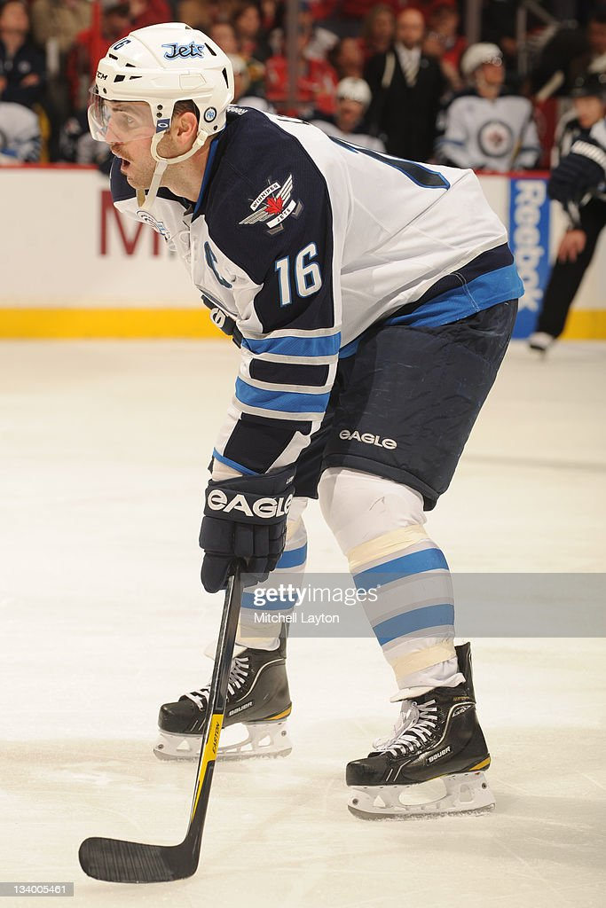<a gi-track='captionPersonalityLinkClicked' href=/galleries/search?phrase=Andrew+Ladd&family=editorial&specificpeople=228452 ng-click='$event.stopPropagation()'>Andrew Ladd</a> #16 of the Winnipeg Jets prepares during a face off of a NHL hockey game against the Washington Capitals on November 23, 2011 at the Verizon Center in Washington, DC.