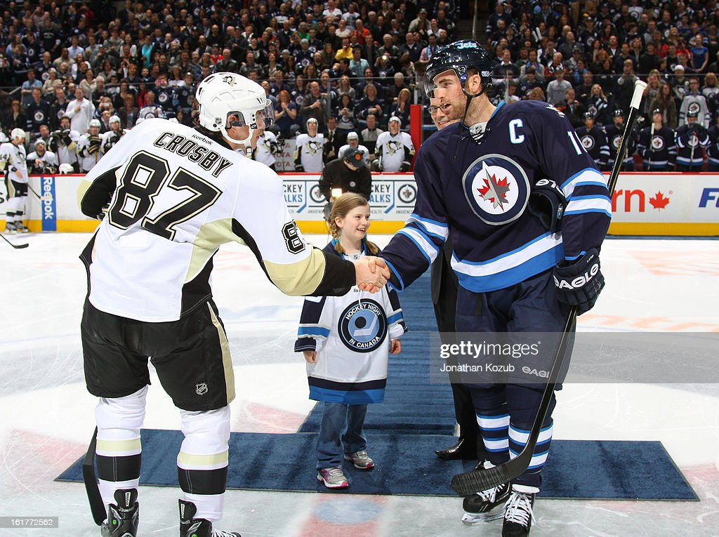 Andrew Ladd #16 of the Winnipeg Jets shakes hands with Sidney Crosby #87 of the Pittsburgh Penguins after the ceremonial face-off prior to NHL action at the MTS Centre on February 15, 2013 in Winnipeg, Manitoba, Canada.