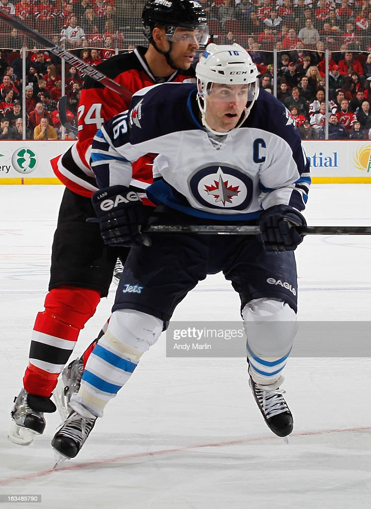 <a gi-track='captionPersonalityLinkClicked' href=/galleries/search?phrase=Andrew+Ladd&family=editorial&specificpeople=228452 ng-click='$event.stopPropagation()'>Andrew Ladd</a> #16 of the Winnipeg Jets skates against the New Jersey Devils during the game at the Prudential Center on March 10, 2013 in Newark, New Jersey.