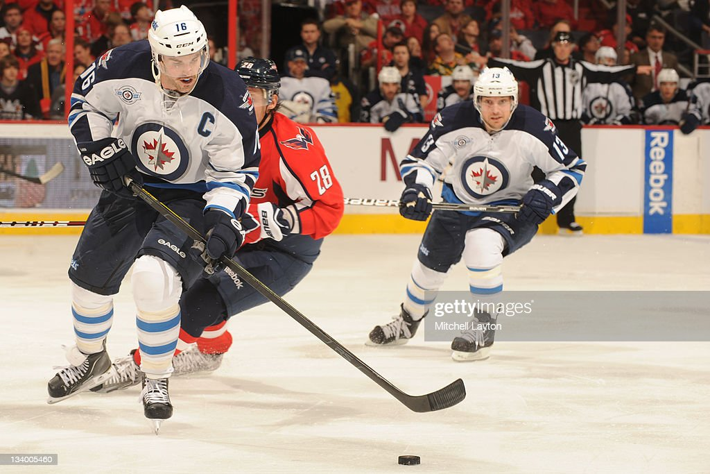 <a gi-track='captionPersonalityLinkClicked' href=/galleries/search?phrase=Andrew+Ladd&family=editorial&specificpeople=228452 ng-click='$event.stopPropagation()'>Andrew Ladd</a> #16 of the Winnipeg Jets skates with the puck during a NHL hockey game against the Washington Capitals on November 23, 2011 at the Verizon Center in Washington, DC.
