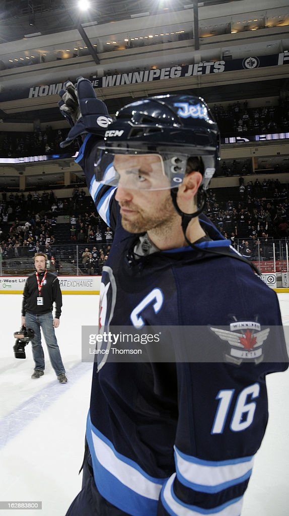 Andrew Ladd #16 of the Winnipeg Jets waves to the home fans after being named the first star of the game following a 3-1 victory over the New Jersey Devils at the MTS Centre on February 28, 2013 in Winnipeg, Manitoba, Canada.
