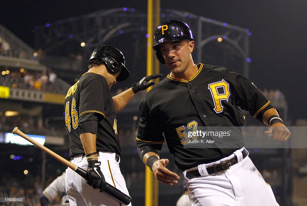 Andrew Lambo #57 of the Pittsburgh Pirates scores on an RBI single in the sixth inning against the Milwaukee Brewers during the game on August 27, 2013 at PNC Park in Pittsburgh, Pennsylvania.
