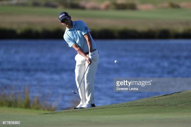 Andrew Landry of the United States plays a shot on the 15th hole during the final round of The RSM Classic at Sea Island Golf Club Seaside Course on...