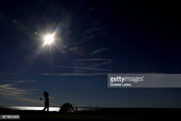 Andrew Landry of the United States plays his shot from the 14th tee during the final round of The RSM Classic at Sea Island Golf Club Seaside Course...
