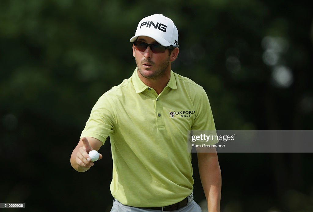Andrew Landry of the United States waves to the gallery after a birdie on the second hole during the first round of the US Open at Oakmont Country...