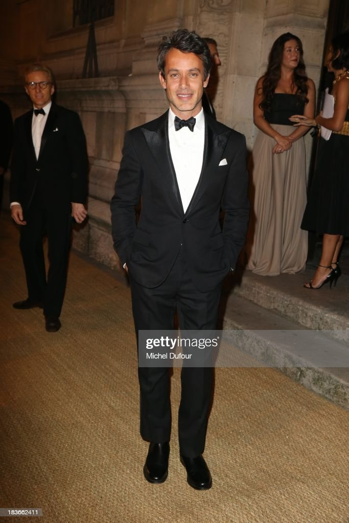<a gi-track='captionPersonalityLinkClicked' href=/galleries/search?phrase=Andrew+Lauren&family=editorial&specificpeople=2304533 ng-click='$event.stopPropagation()'>Andrew Lauren</a> arrives at a Ralph Lauren Collection Show and private dinner at Les Beaux-Arts de Paris on October 9, 2013 in Paris, France. On this occasion Ralph Lauren celebrates the restoration project and patron sponsorship of L'Ecole des Beaux-Arts.