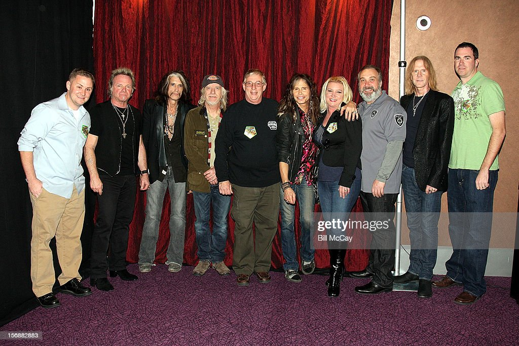 Andrew Leonard, Joey Kramer, Joe Perry, Brad White, Joe Paparone, Steven Tyler, Charlene Ruark, Rodney Ruark, Tom Hamilton and Kevin Fair attend Aerosmith Meets Atlantic City & Brigantine, New Jersey Hurricane Sandy First Responders pose at Ovation Hall at Revel Casino November 23, 2012 in Atlantic City, New Jersey.