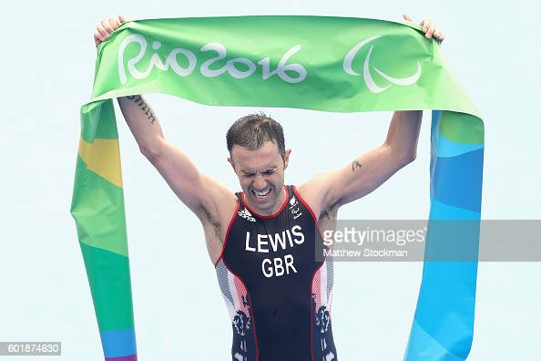 Andrew Lewis of Great Britain crosses the finish line to win the men's triathlon PT12 at Fort Copacabana during day 3 of the Rio 2016 Paralympic...