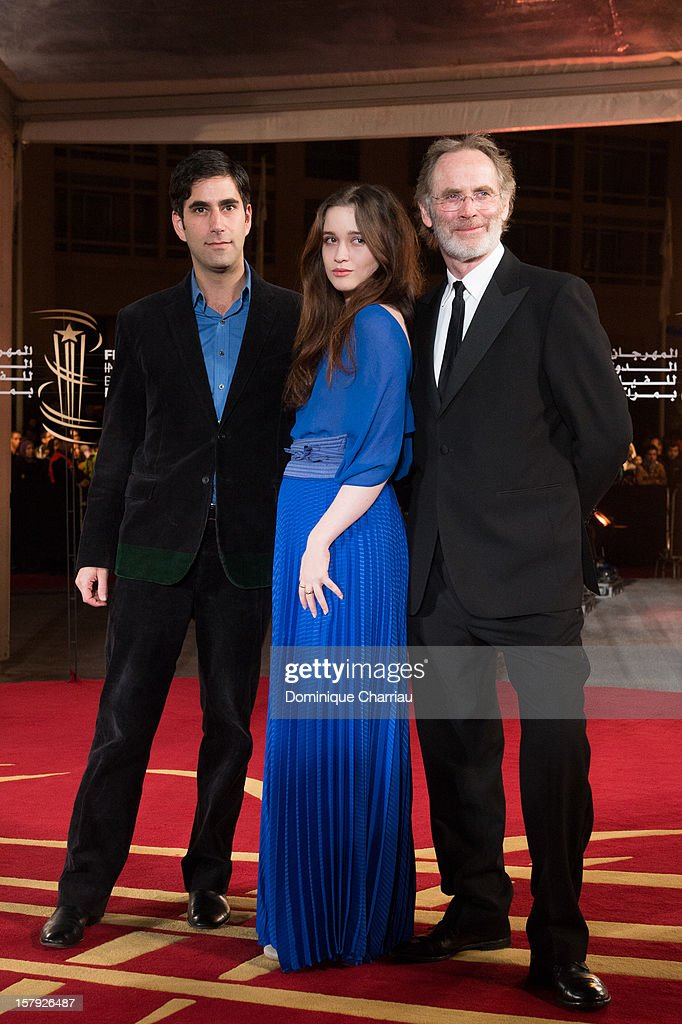 Andrew Litvin, <a gi-track='captionPersonalityLinkClicked' href=/galleries/search?phrase=Alice+Englert&family=editorial&specificpeople=616562 ng-click='$event.stopPropagation()'>Alice Englert</a> and Christopher Sheppard pose as they arrive at the 'Ginger & Rosa' Premiere during the 12th International Marrakech Film Festival on December 7, 2012 in Marrakech, Morocco.