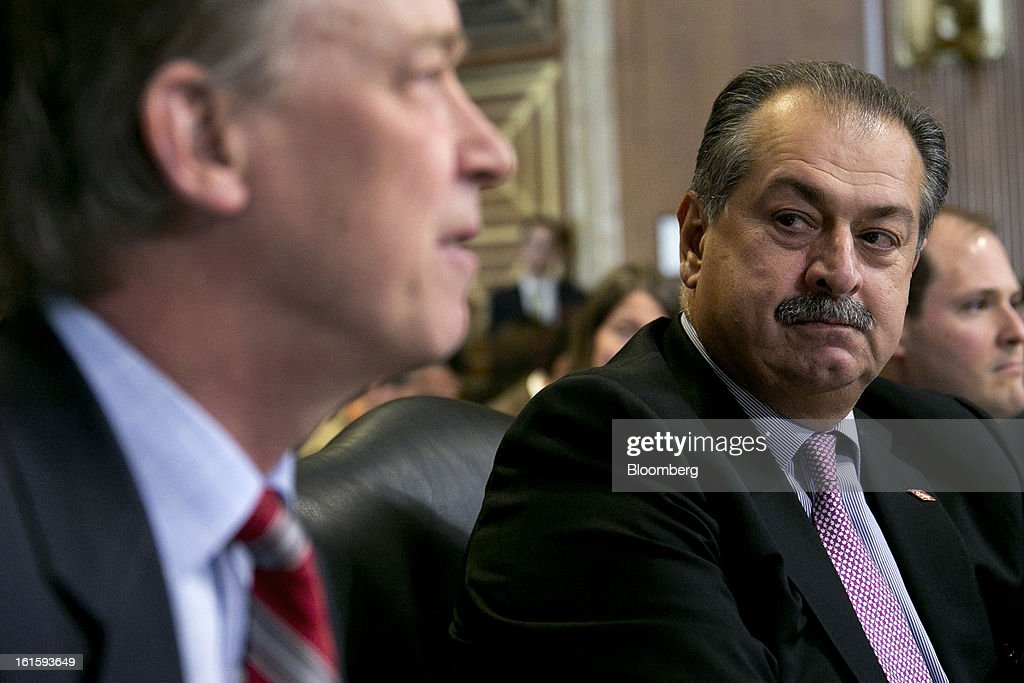 Andrew Liveris, chairman and chief executive officer of Dow Chemical Co., right, looks on as John Hickenlooper, governor of Colorado, speaks during a Senate Energy and Natural Resources Committee hearing in Washington, D.C., U.S., on Tuesday, Feb. 12, 2013. The top two members of a Senate committee for energy split over expanding U.S. natural gas exports, mirroring a disagreement between fuel consumers such as Dow Chemical Co. and producers such as Exxon Mobil Corp. Photographer: Andrew Harrer/Bloomberg via Getty Images