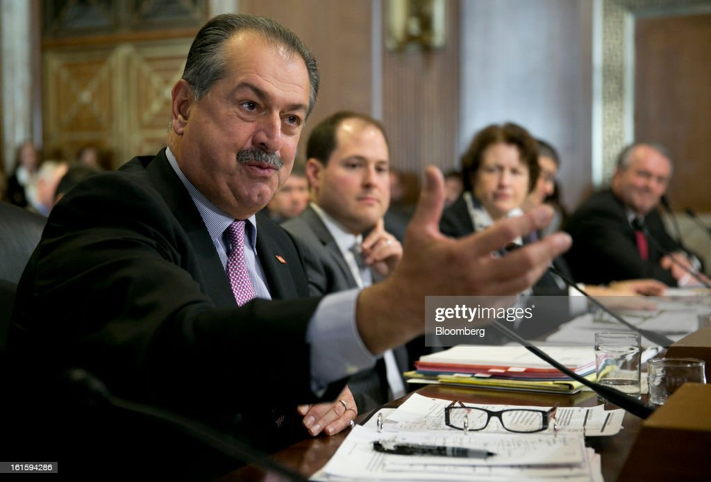 Andrew Liveris, chairman and chief executive officer of Dow Chemical Co., far left, speaks during a Senate Energy and Natural Resources Committee hearing with Ross Eisenberg, vice president of energy and resources policy at the National Association of Manufacturers, left to right, Frances Beinecke, president of the Natural Resources Defense Council, Kenneth Medlock, senior director at the Center for Energy Studies, and Jack Gerard, president and chief executive officer at the American Petroleum Institute, testify during a Senate Energy and Natural Resources Committee hearing in Washington, D.C., U.S., on Tuesday, Feb. 12, 2013. The top two members of a Senate committee for energy split over expanding U.S. natural gas exports, mirroring a disagreement between fuel consumers such as Dow Chemical Co. and producers such as Exxon Mobil Corp. Photographer: Andrew Harrer/Bloomberg via Getty Images
