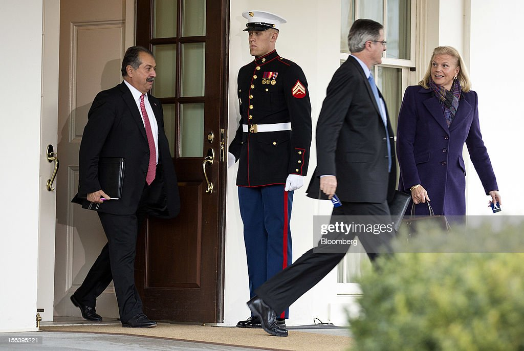 Andrew Liveris, left, chief executive officer of Dow Chemical Co., left, and John Watson, chief executive officer of Chevron Corp., follow <a gi-track='captionPersonalityLinkClicked' href=/galleries/search?phrase=Ginni+Rometty&family=editorial&specificpeople=6246120 ng-click='$event.stopPropagation()'>Ginni Rometty</a>, chief executive officer of International Business Machines Corp., as they depart from the West Wing of the White House after meeting with U.S. President Barack Obama in Washington, D.C., U.S., on Wednesday, Nov. 14, 2012. Obama met with a dozen corporate leaders at the White House today in his latest overture to the business community as he works to build support for a debt deal that includes new taxes on wealthy Americans. Photographer: Joshua Roberts/Bloomberg via Getty Images
