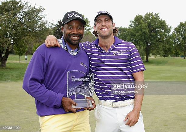 Andrew Loupe and his caddie Wayne Birch pose with the champions trophy after winning the Webcom Tour Nationwide Children's Hospital Championship at...