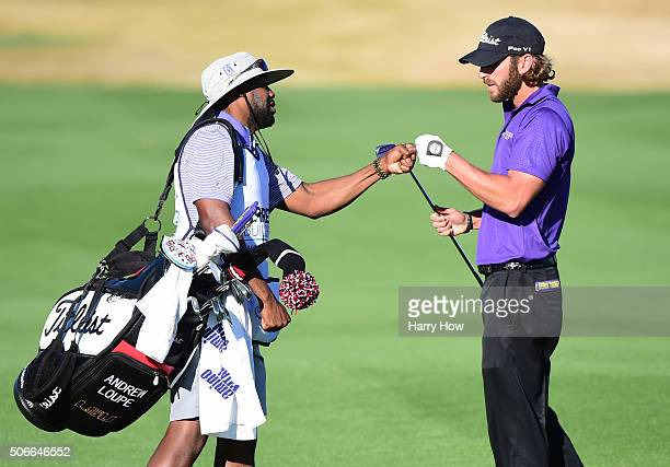 Andrew Loupe celebrates with his caddie after his second shot on the 16th hole during the final round of the CareerBuilder Challenge In Partnership...