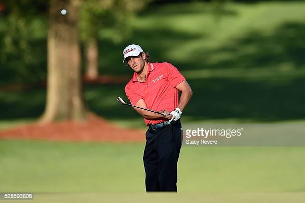 Andrew Loupe chips to the 12th green during the second round of the Wells Fargo Championship at Quail Hollow Club on May 6 2016 in Charlotte North...
