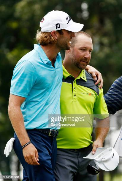 Andrew Loupe of the United States embraces Chad Collins of the United States after they finish on the on the 18th green during the second round of...