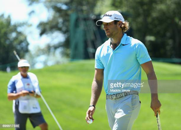 Andrew Loupe of the United States reacts on the 11th green during the first round of the Travelers Championship at TPC River Highlands on June 22...