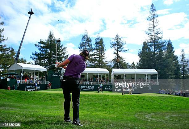 Andrew Loupe plays a shot after taking relief from the score board on the 17th hole during the third round of the Fryscom Open on October 17 2015 at...