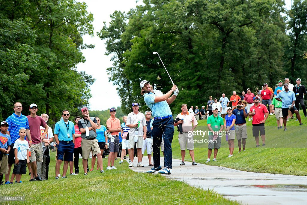 Andrew Loupe plays a shot on the seventh hole during the continuation of the first round of the John Deere Classic at TPC Deere Run on August 12 2016...