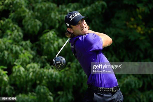 Andrew Loupe plays his shot from the second tee during the final round of the John Deere Classic at TPC Deere Run on August 14 2016 in Silvis Illinois