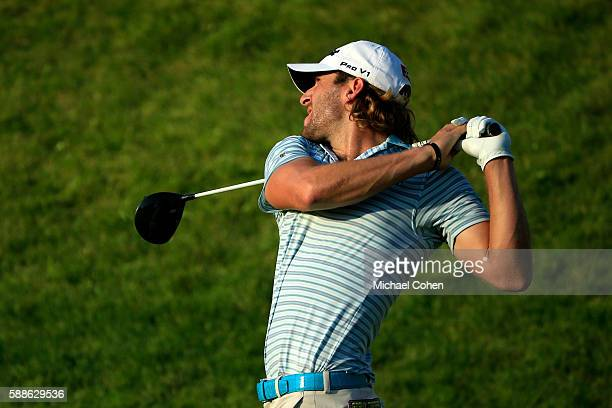 Andrew Loupe plays his shot from the tenth hole during the first round of the John Deere Classic at TPC Deere Run on August 11 2016 in Silvis Illinois