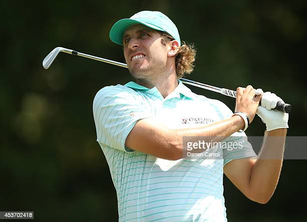 Andrew Loupe plays his tee shot on the seventh hole during the third round of the Wyndham Championship at Sedgefield Country Club on August 16 2014...